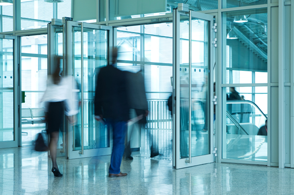 People Walking Through Entrance Door